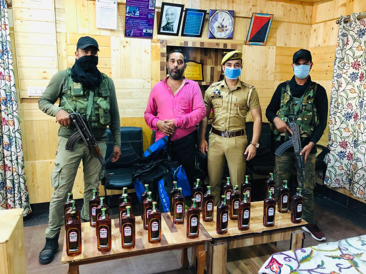 Sopore Police Arrested Bootlegger with 25 Bottles of illicit Liquor
